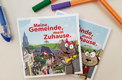 """Im Kinderbuch werden die wichtigsten Aufgaben der Gemeinden von """"Franz"""" und """"Lisi"""" kindgerecht aufbereitet. ©Gemeindebund"""